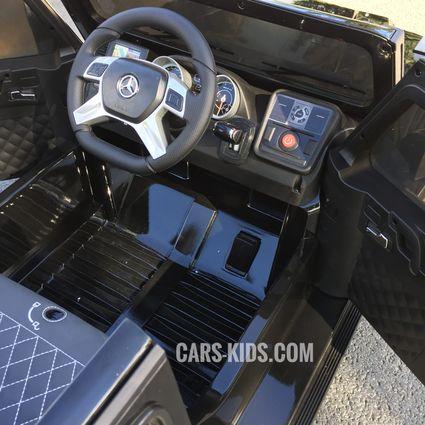 Электромобиль Mercedes-Benz G65 AMG черный (АКБ 12v 7ah, колеса резина, сиденье кожа, пульт, музыка)